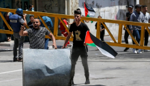 Palestinian demonstrators in the city of Hebron, Friday, May 14