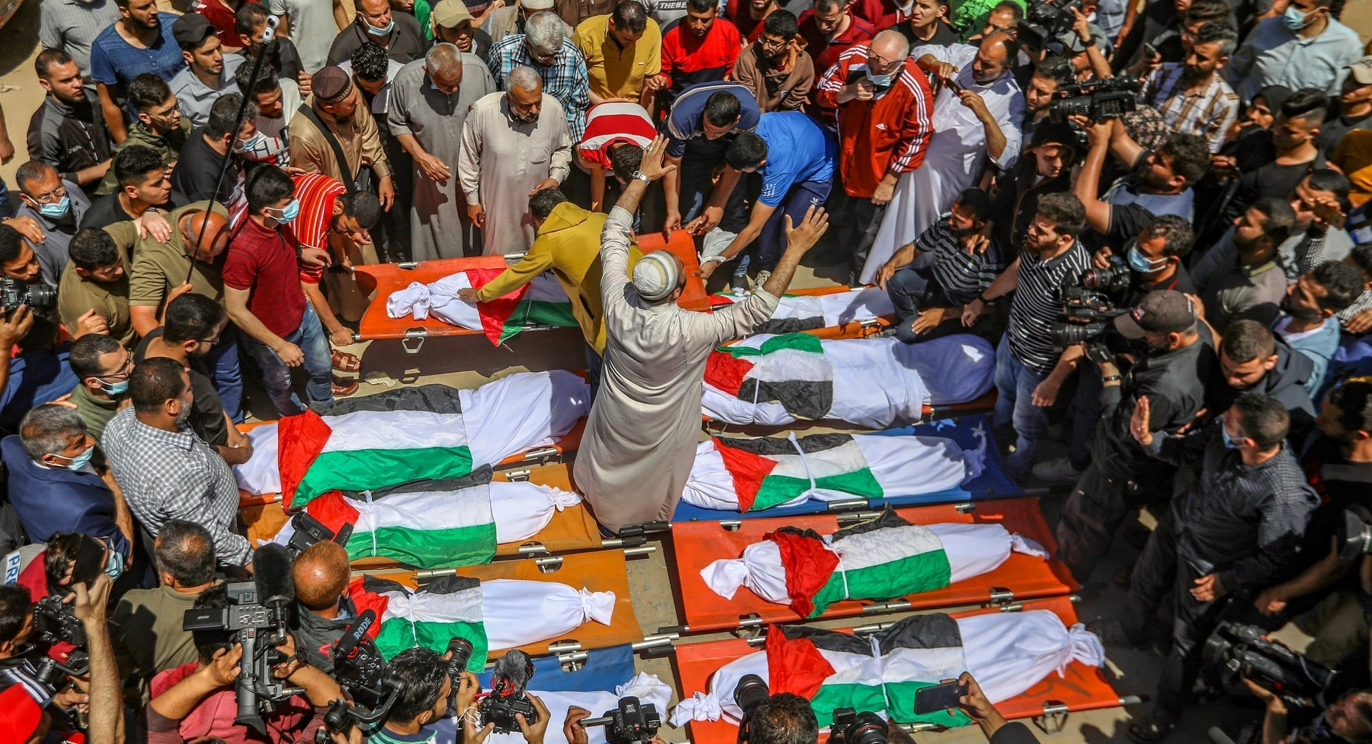 Thousands of Palestinians attend the funeral of the Abu Hatab family in Gaza City. Eight children and two women were killed in the three-store building in the Shati refugee camp, in the northern Gaza Strip, which collapsed following an Israeli airstrike, May 15, 2021.