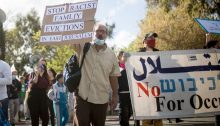 Palestinians and Israelis jointly demonstrate in Sheikh Jarrah against the eviction of long-time Palestinian refugee families from their occupied East Jerusalem neighborhood, April 10, 2021.