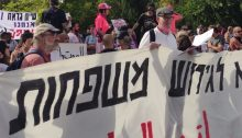 """Protestors decry the eviction of families of Palestinian refugees from their homes in Sheikh Jarrah, occupied East Jerusalem, Friday May 21, 2021. The large banner reads: """"No to the Eviction of Families."""""""