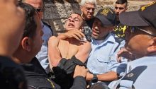 A Palestinian protester is forcibly arrested by Israeli police on Wednesday, May 26, near the Jerusalem District Court.