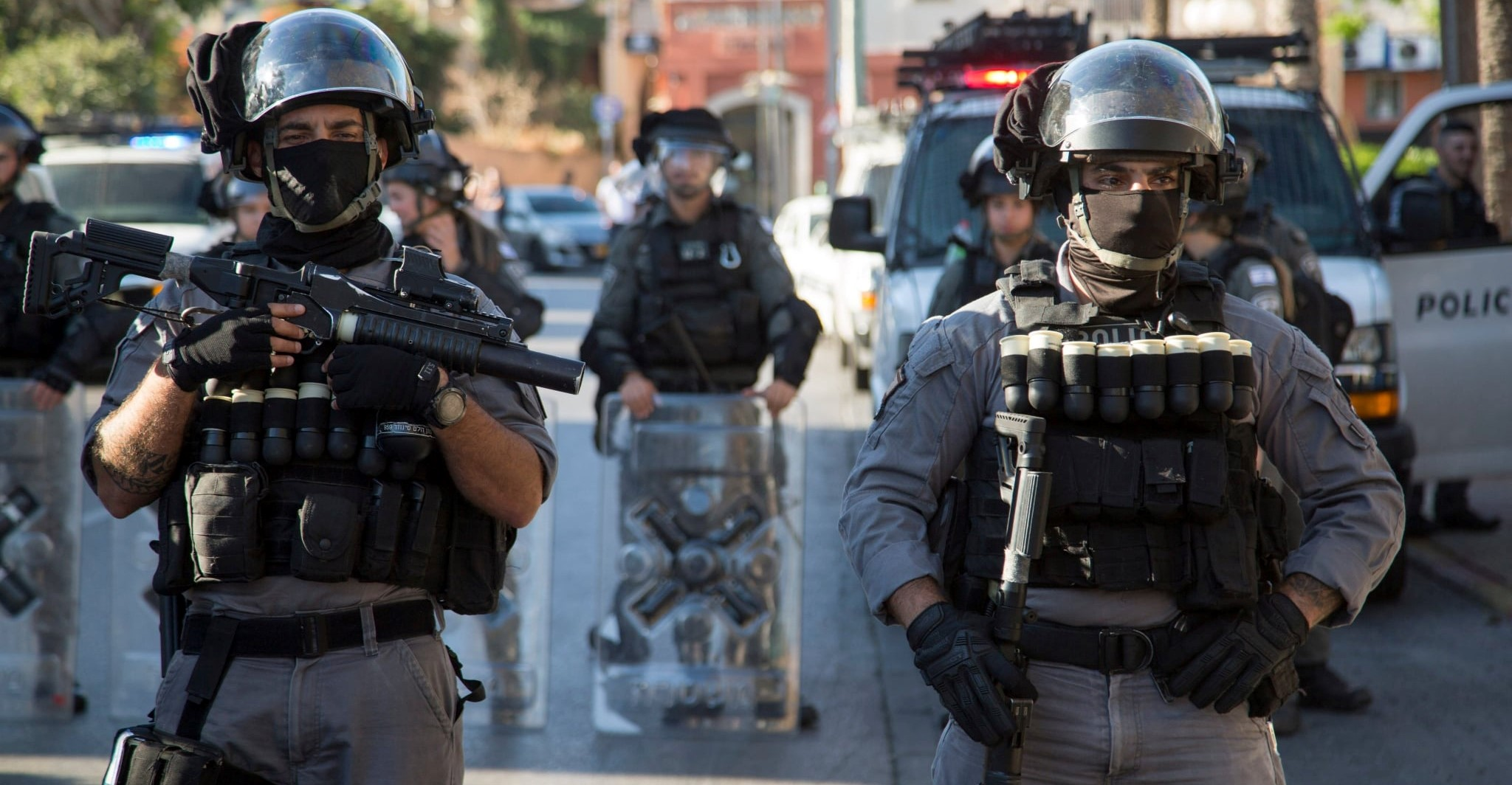 Israel's highly militarized police stand ready to confront protesters in the streets of Arab Jaffa, May 21, 2021.