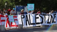 """Demonstrators rally in solidarity with Palestinian residents of Sheikh Jarrah in occupied East Jerusalem, last Friday, June 4. Among the demonstrators was Hadash MK Ofer Cassif. The placards in Arabic read """"End the Occupation."""""""