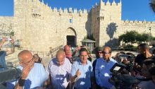 """Joint List chair MK Ayman Odeh (Hadash, center) addresses the press conference held at the Damascus Gate (Bab al-Amoud) in occupied East Jerusalem prior to the jingoistic """"Flag Parade,"""" Tuesday, June 15, 2021."""