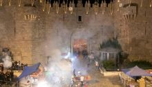 The smoke from the explosion of stun grenades hovers over the Damascus Gate plaza in occupied East Jerusalem, May 9, 2021.