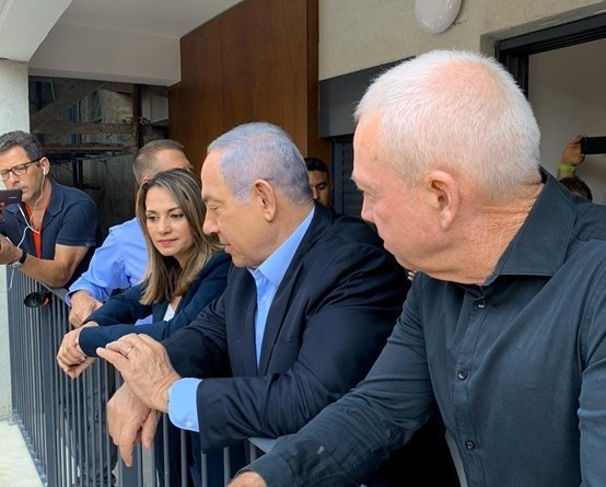 Israel's current Education Minister, Yifat Shasha-Biton, during her tenure as a Likud MK, confers with then-Prime Minister Benjamin Netanyahu and Education Minister Yoav Galant.