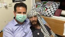 Joint List chair, MK Ayman Odeh (Hadash), visits the Palestinian administrative prisoner, Ghadanfar Abu Atwan, at Kaplan Hospital in Rehovot, last Thursday, July 8, 2021.