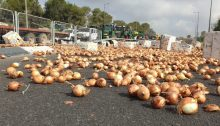Agricultural produce spilled on a road by farmers protesting the government's agricultural reform, Thursday, July 29, 2021