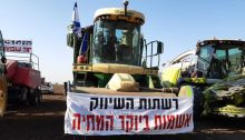 """Farmers protest the government's neoliberal agricultural reforms being introduced in framework of the new budget, Thursday, July 29, 2021. The large banner reads: """"The marketing chains are to blame for the high cost of living."""