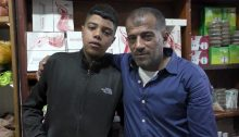 Sanad Muqbal with his father Muhammad at the family grocery store, June 22, 2021