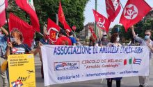 """Demonstrators in Milano, Italy parade in solidarity with the Cuban revolution. The yellow placard to the left reads: """"Put an end to the economic warfare against Cuba!"""""""