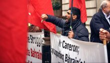 Hacked Bahraini activist Mousa Abd-Ali protesting in front of the Bahraini Embassy in London