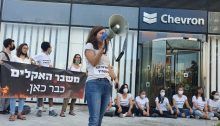 """""""Climate crisis is here"""": Israeli environmental activists demonstrate in front of the Israeli headquarters of the US Chevron Oil Company in Herzliya, last Wednesday, August 25, 2021."""