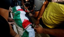 Relatives and friends mourn over the body of 39-year-old Raed Jadallah, killed by Israeli occupation soldiers near the West Bank town of Beit Ur al-Tahta on Tuesday evening, August 31, 2021. Jadallah, the father of 5, had been returning home from a day of work in Jerusalem when he was gunned down and left to bleed to death.