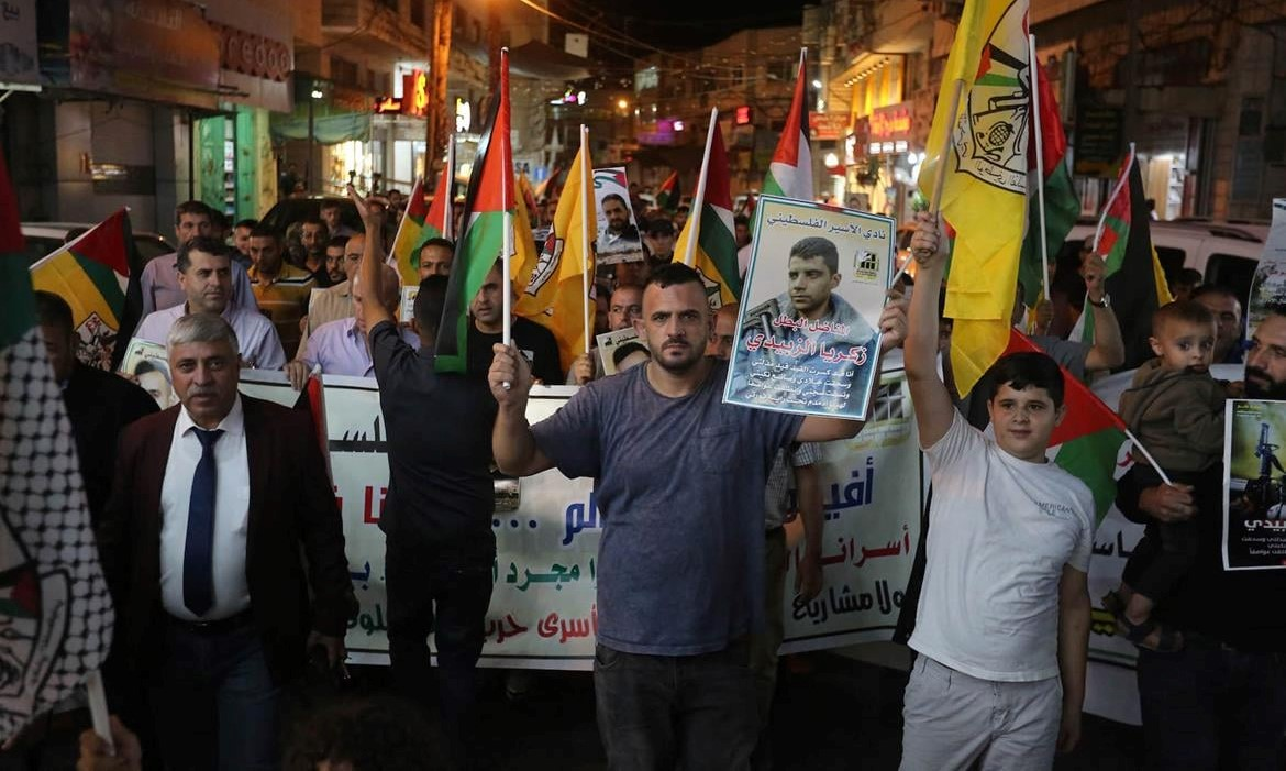Palestinians demonstrate in Hebron Wednesday night, September 8, in solidarity with their incarcerated brethren.