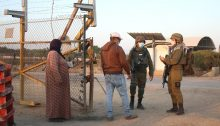 Occupation soldiers verify the identity of Palestinian farmers in the West Bank.