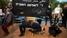 """Israeli activists mark International Human Rights Day by demonstrating in front of the Tel Aviv offices of Israel's Internal Security Service (Shin Bet/Shabak) to protest political arrests of Palestinians, December 10, 2020. The black banner reads: """"Enough of Shabak Rule."""""""