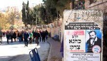 """A previous tour of Hebron organized by Breaking the Silence. The poster to the right commemorates the anniversary of the 1990 assassination of the arch-racist Rabbi Meir Kahana and reads """"Rabbi Kahana was right!"""""""