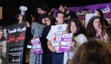 Citizens demonstrate against the escalating violence and crime in Israel's Arab communities outside of Public Security Minister Omer Bar-Lev's home in the town of Kokhav Ya'ir on Saturday night, September 25. In the center is MK Ayman Odeh, chair of the Joint List.