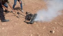 Palestinian protestors approach the Israeli quadcopter that had been dropping tear gas on them after downing it on Friday, October 1, in Beita in the occupied South Hebron Hills.
