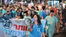 Dr. Rey Biton, head of the Mirsham union of medical residents (with the megaphone) leads the Saturday night rally held in Tel Aviv to reduce the work shift of resident physicians in hospitals.
