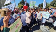 Joint List lawmaker Aida Touma-Sliman (Hadash) addresses protesting daycare center workers who gathered near the Knesset, October 5, 2021.